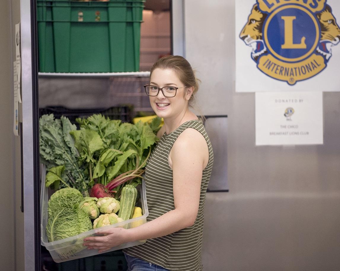 Photo   chicocares 2   katie at fridge with veggies