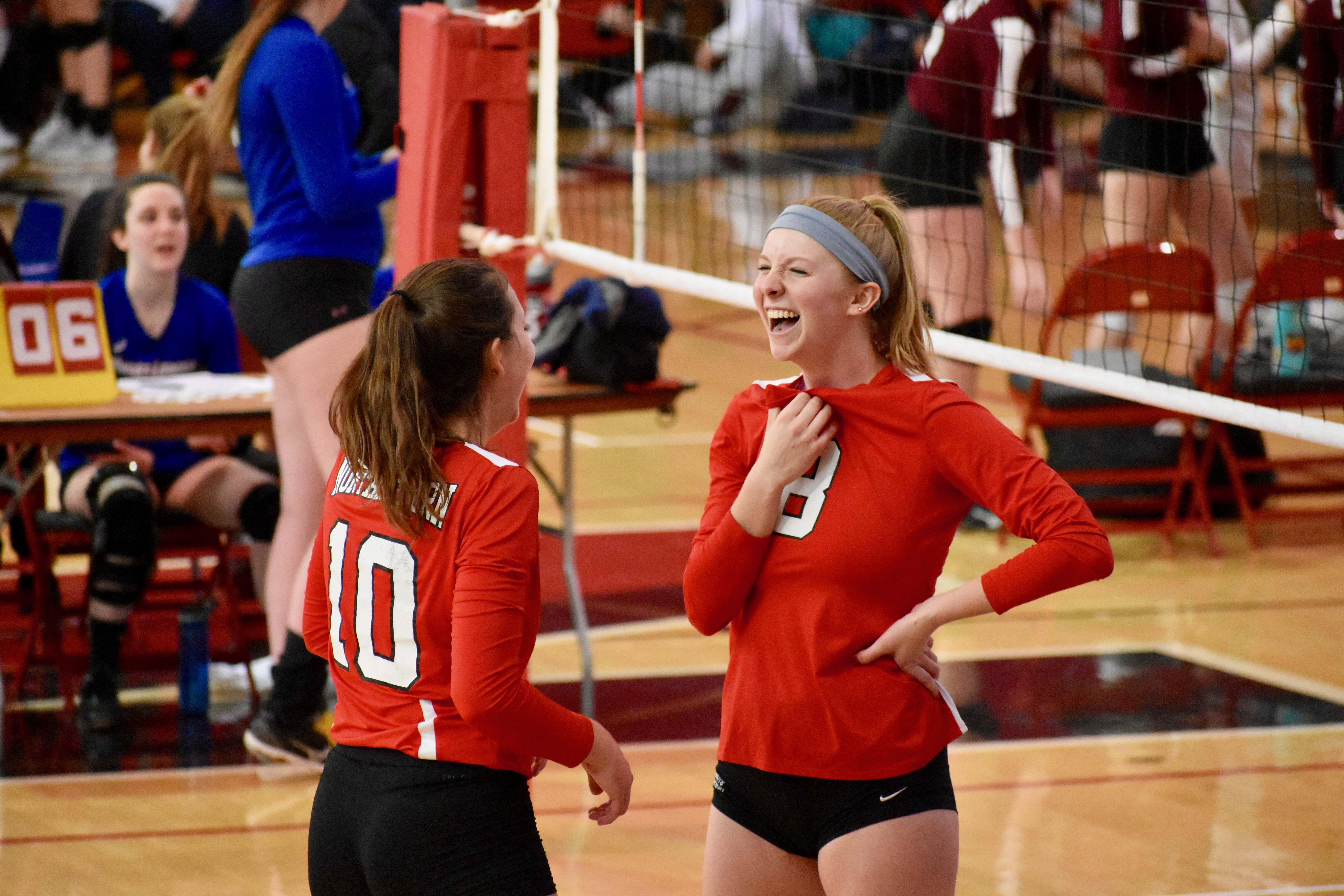 Two teammates mid game laughigh candid