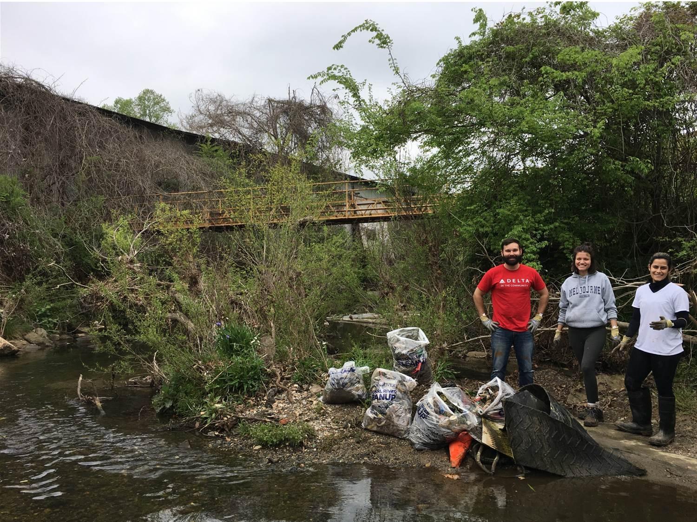 Volunteer with trash pile