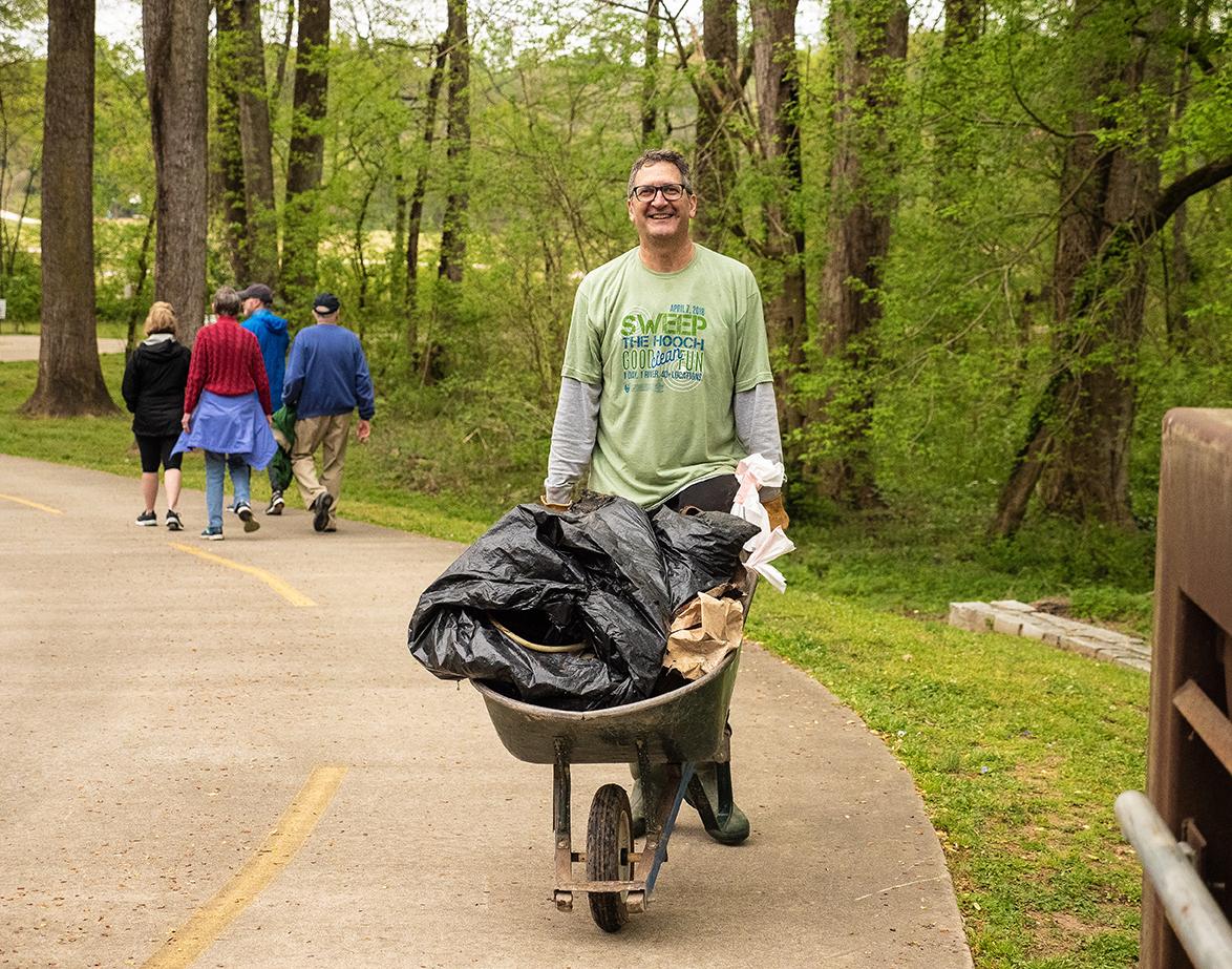 Volunteer with wheelbarrow