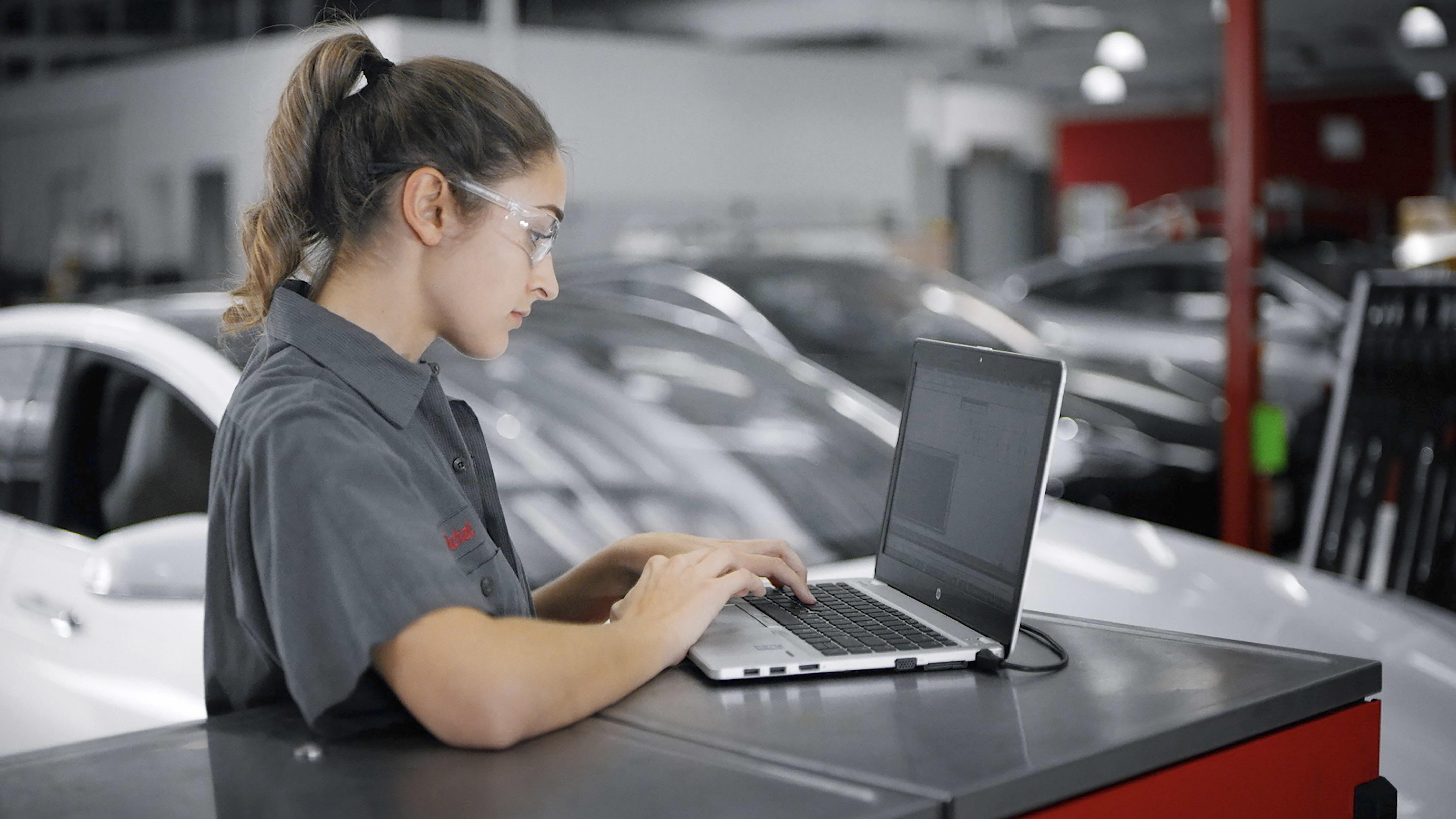 Female technician laptop print