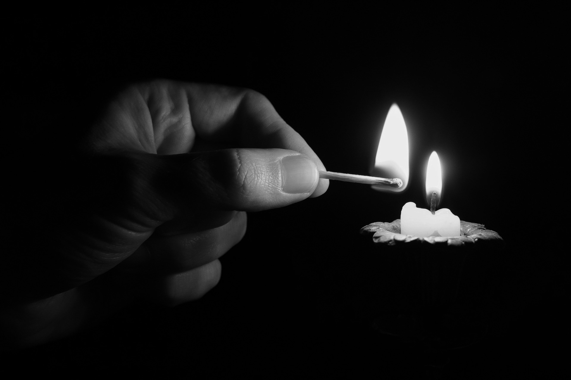 Candle hand bw