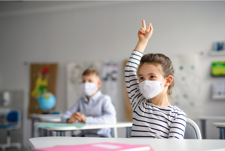 Girl in school with mask