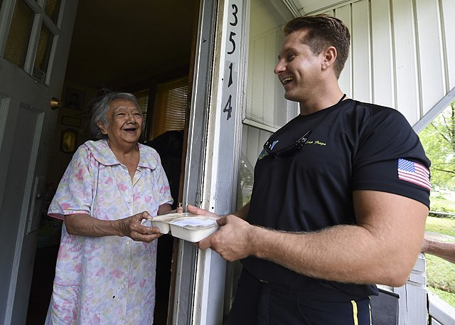 640px sailor delivers meals on wheels to elderly and homebound residents. %2835855356622%29