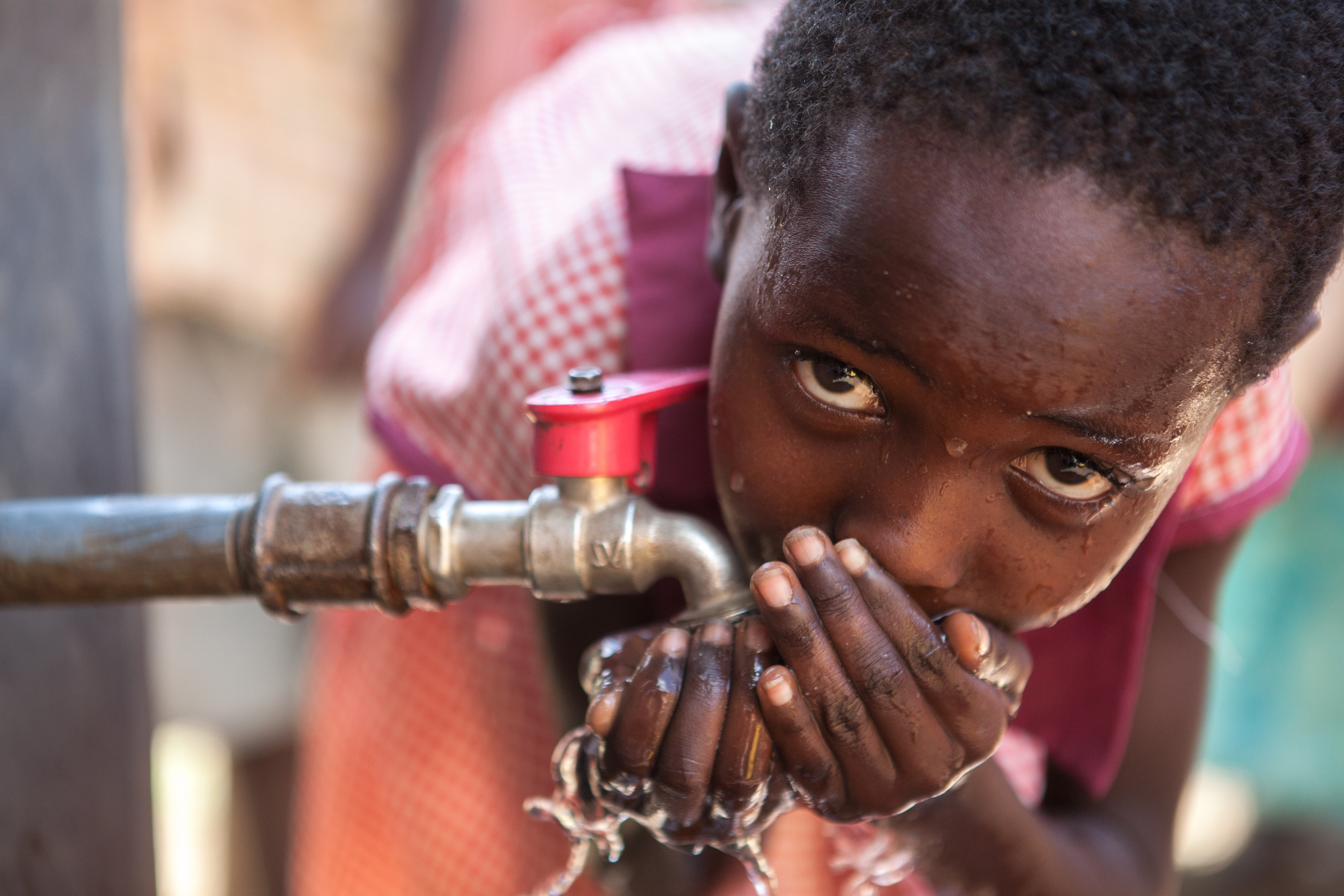 African girl clean water