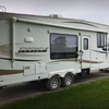 RV for Sale: 2011 LEXION S-LITE 295RKSA