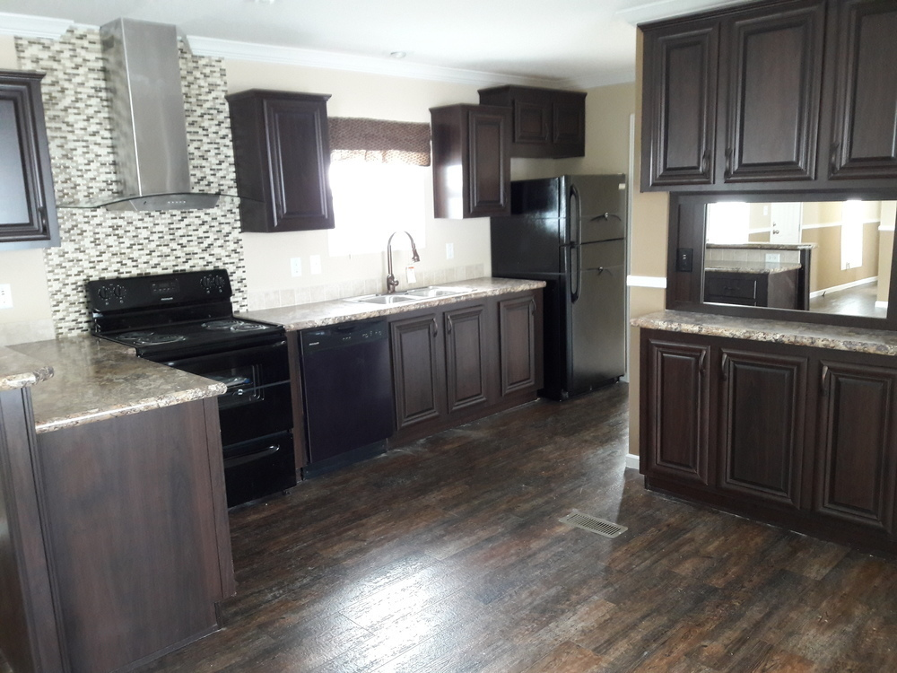Dark hardwood cabinets and a kitchen pantry