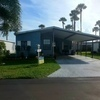 Mobile Home for Sale: 2 Bed/2 Bath Home With Backyard Deck & Amazing Lake View, Melbourne, FL
