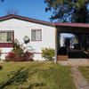 Mobile Home for Sale: Rancher, Manuf, Dbl Wide Manufactured, Leased Land - Post Falls, ID, Post Falls, ID