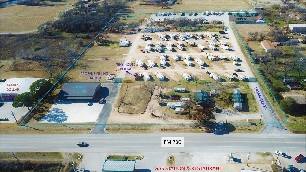 Aerial view showing boundaries, office building, pads, rentals, rec area, club house, etc.
