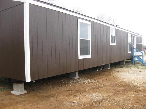 e44337db-65f8-4aaa-9564-abdac5200b42  Fleetwood Single Wide Mobile Home on looks like cabin, exterior paint colors, end porches, log cabin style,