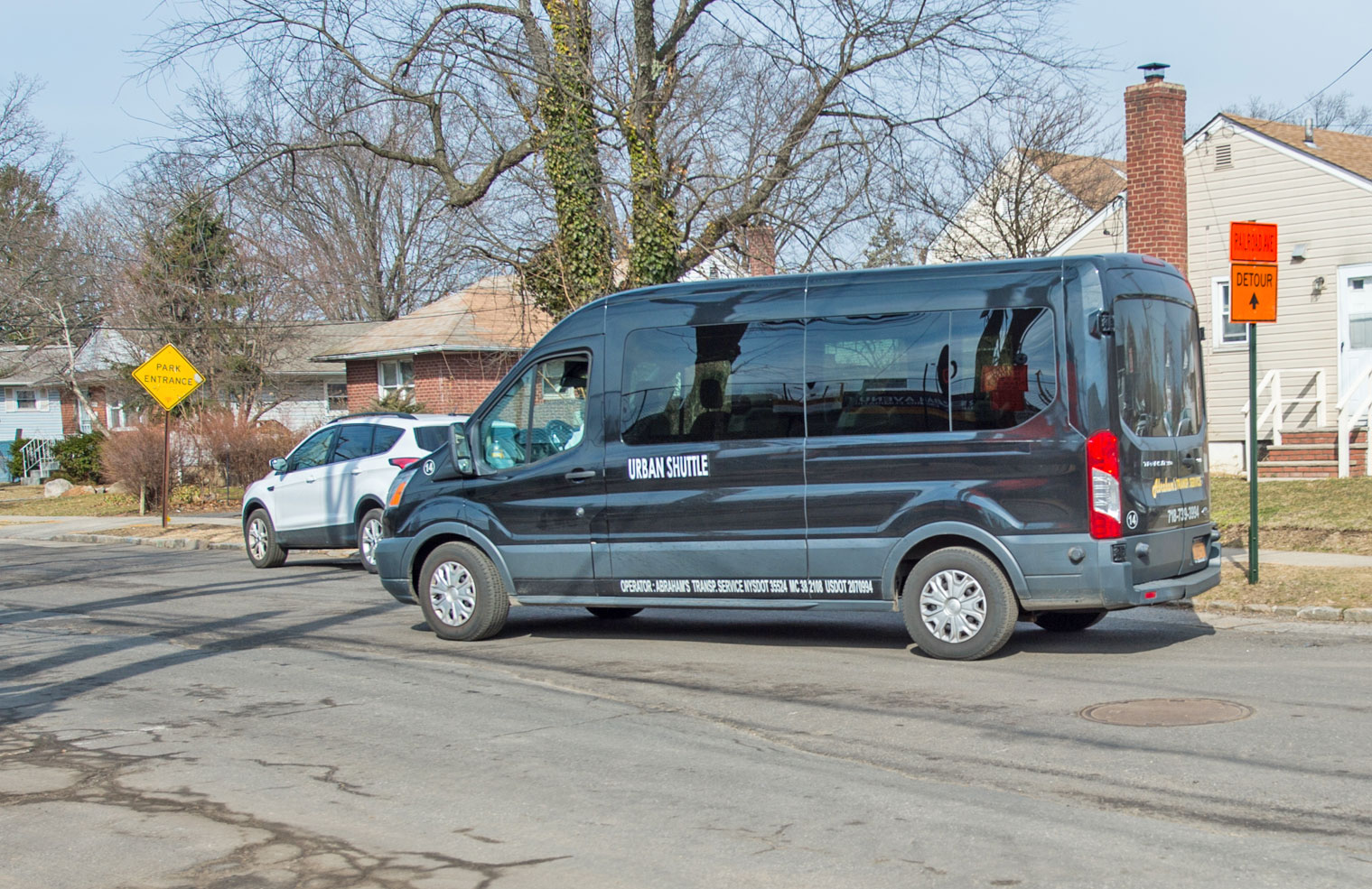 Free Shuttle Bus Conveys Pedestrians Safely Back and Forth
