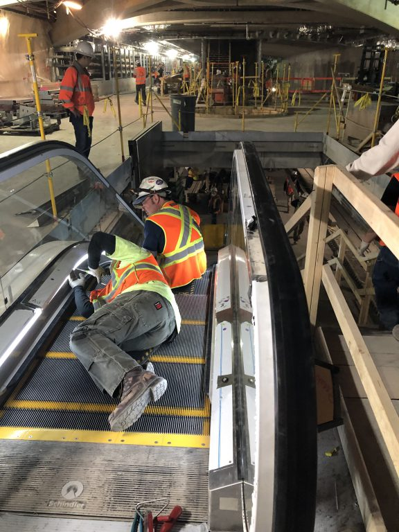 Escalator Installation between the Mezzanine and Lower Levels of the West Cavern. 04-12-19