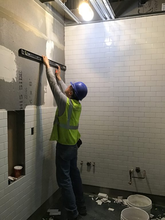 Tile finishes being installed in the back of house area of the future LIRR passenger concourse 04-12-19