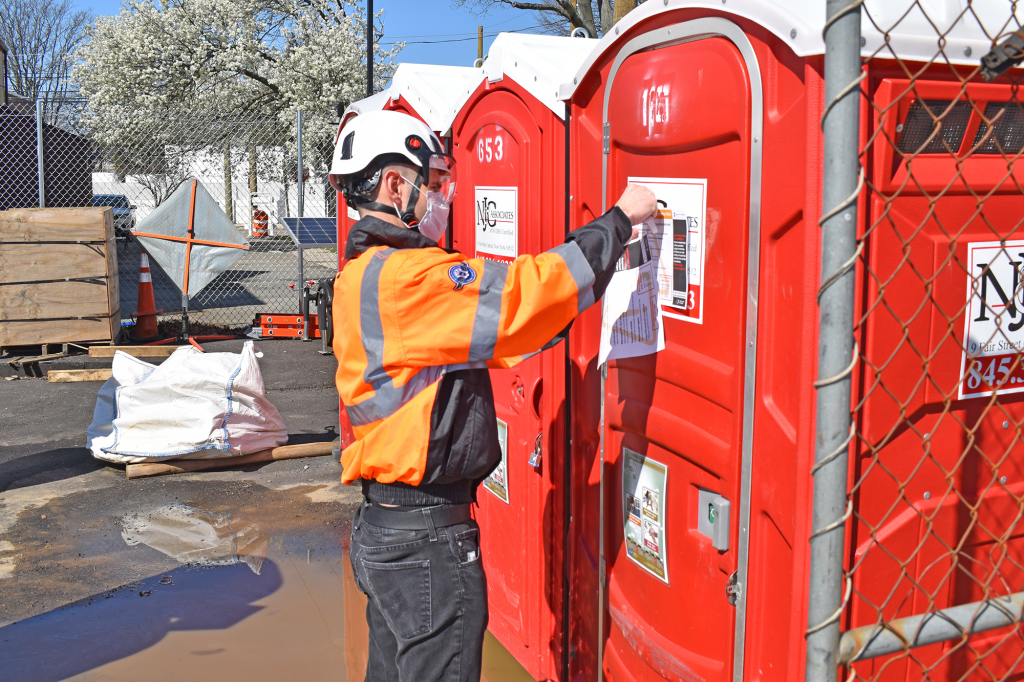 Evan Arctander, safety lead on the Third Track project, is posting flyers reminding workers about COVID-19 guidelines. 04-13-20
