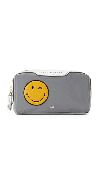 'Wink Girlie Stuff' leather smiley reflective nylon pouch