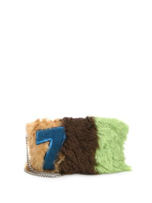 patchwork shearling clutch