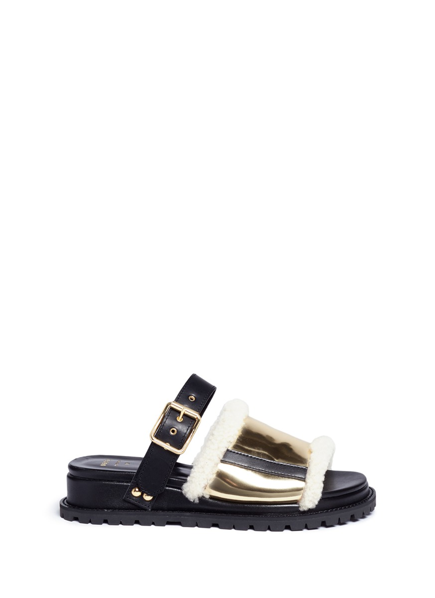 Buckled leather and mirror shearling slide sandals