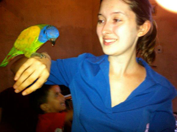 Karimeh Moukaddem in Brazil with pet parrot. She says she does 'not condone owning parrots.' Photo courtesy of Karimeh Moukaddem.