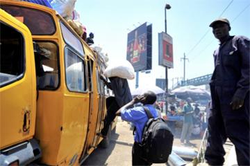 A crowded bus in Nairobi, Kenya. Image courtesy of Alex Kamweru.