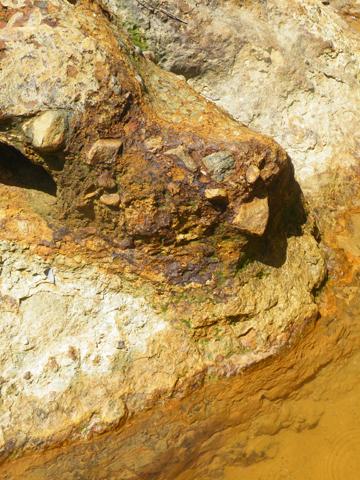 Impact of acid mine drainage, same stream. Photo by: Robin Oisín Llewellyn.