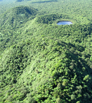Ariel shot of upland Savaii, a region that holds many of Samoa's endemic species, and the craters that form there. Photo by: Rebecca Stirnemann.