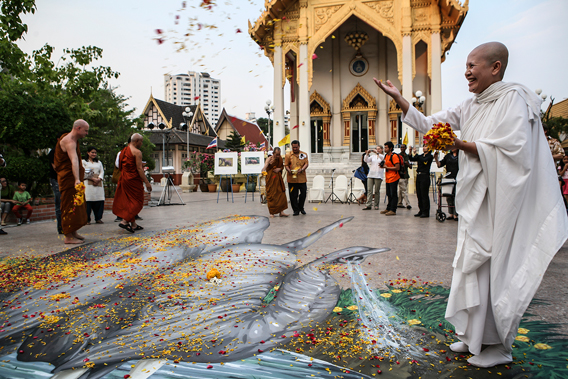 MA monk at Wat That Thong temple in Bangkok During a Buddhist merit-making ceremony to pray for the tens of thousands of elephants poached annually. Photo by: © WWF Thailand.