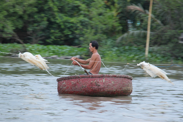 Traditional fishing on the Mekong. Photo courtesy of FISHBIO.