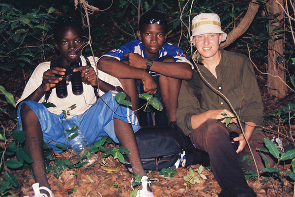 Amy Clanin with two students observing chimpanzees at the Fongoli research site in Senegal. Photo courtesy of Amy Clanin.
