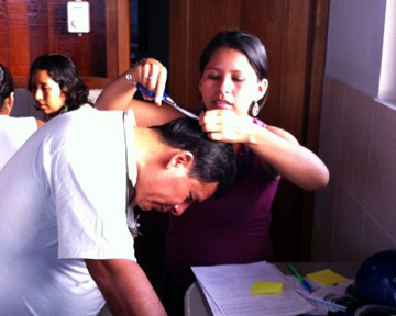 Taking hair samples to test for mercury. Photo courtesy of: Luis Fernandez.