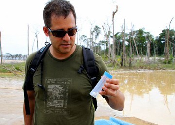 Luis Fernandez taking water sample. Photo courtesy of: Luis Fernandez.