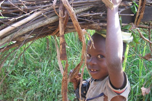 Boy carrying wood. Photo courtesy of New Nature Foundation.