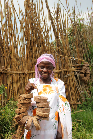 Local woman shows off her biomass briquettes or eco-char. Photo courtesy of New Nature Foundation.