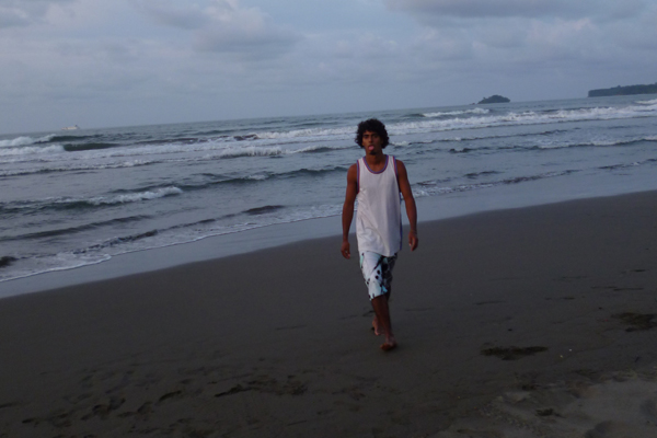 Jairo Mora Sandoval walking on the beach where he died after releasing over a hundred turtle hatchlings in 2012. Photo by: Carlyn Samuel.