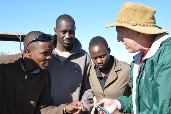 Research associate Dr. Rick Brenneman of Henry Doorly Omaha Zoo with locals in Botswana with genetic samples of giraffes. Photo courtesy of Julian Fennessy.