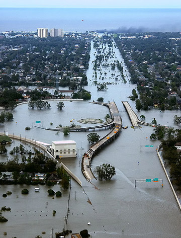 A flooded New Orleans following Hurricane Katrina, showing Interstate 10 at West End Boulevard. Photo by: U.S. Coast Guard, Petty Officer 2nd Class Kyle Niemi.
