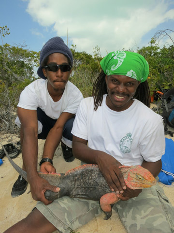 Bahamas National Trust staff assistants with iguana. Photo by: ©Shedd Aquarium/Chuck Knapp.