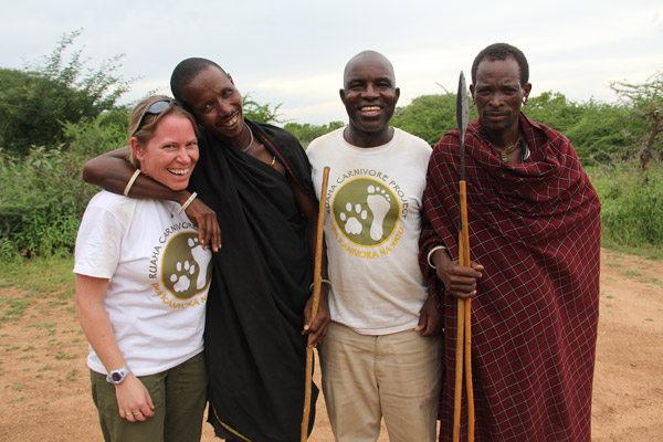 Ruaha Carnivore Project Director Amy Dickman and Community Liaison Ayubu Msago with Barabaig warriors. The little-known Barabaig tribe are traditional pastoralists, and it was vital to work closely with them to reduce both cultural and retaliatory lion killings. Photo by: Pat Erickson.