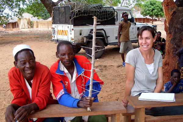 Colleen Begg with local chiefs promoting a living fence (using woody species to fence off villages). Photo by: Niassa Carnivore Project.