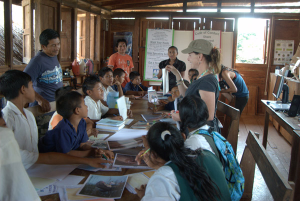 Ghrist at Caiman House at Yupakari Village in Guyana holding a visual and talking to the kids about giant river otters. Photo: © Lucy Spelman.