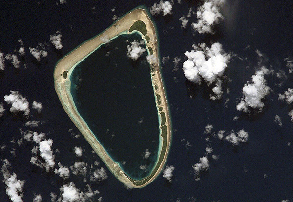 Sattelite image of Ettal Atoll, an island in the Mortlock Islands and home to Pteropus pelagicus. Photo by: NASA.
