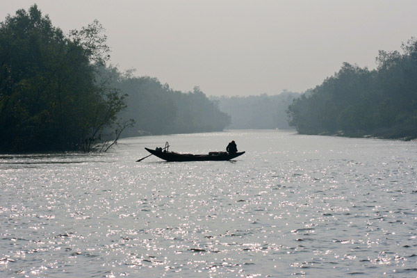 Logging boat in the Sundarbans. Photo by: Pranabesh Das.