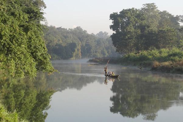 Canoeing is a popular way to see Chitwan. Photo by: Grzegorz Mikusinski.