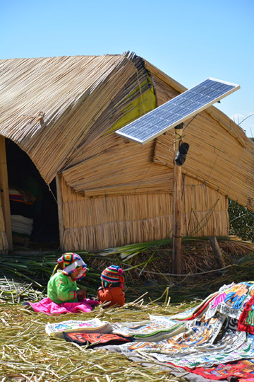Solar panel powering a reed hut on a reed island, Uros, Peru. Photo courtesy of the Kraft family.
