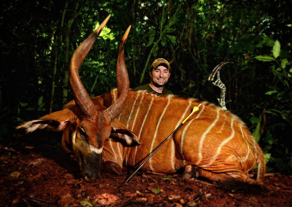 Corey Knowlton posing with a bongo he killed. Photo from Corey Knowlton's Facebook page.