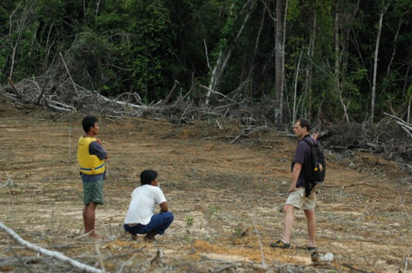 Erik visiting an area that had just been cleared for oil palm development along the Lesan River in Berau, East Kalimantan. Photo by: Ed Meijaard.