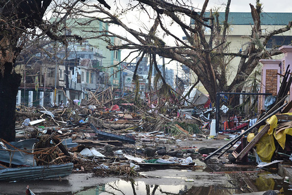 Debris in Tacloban, Philippines after devastating Typhoon Haiyan. While the science connecting climate change to more and worsening hurricanes remains contentious, storm surges are higher due to rising sea levels. Photo by: Trocaire.