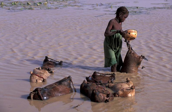 Filling goatskins with water from Lake Banzena. Photo by: Carlton Ward Jr.