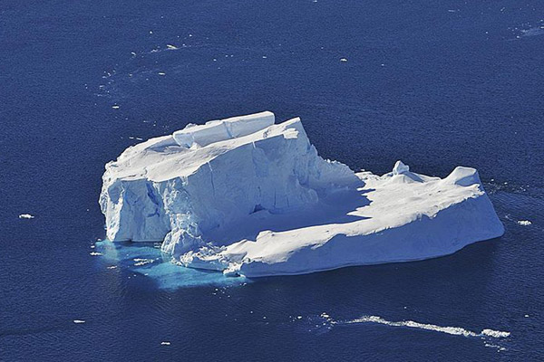 Iceberg in the Amundsen Sea off of Western Antarctica. As the glaciers melt, they often birth massive icebergs. Photo by: NASA.