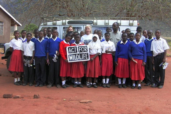 Local school children meet with Maggie Esson in Tanzania. Chester Zoo's Act for Wildlife is working with the George Adamson Wildlife Preservation Trust in Mkomazi National Park with a focus on conserving black rhinos. Photo courtesy of: Act for Wildlife.